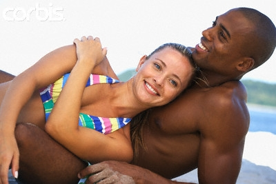 White woman lying on black man chest