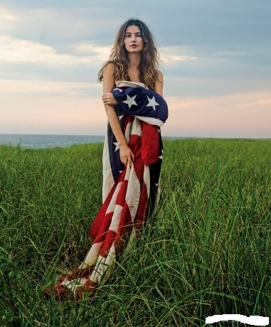 Sexy woman wrapped in a flag