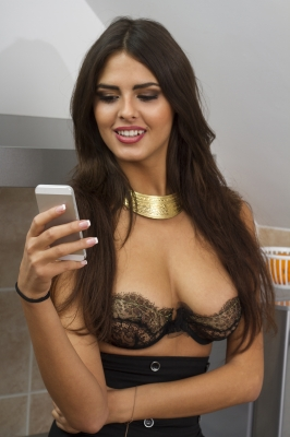 Sexy woman texting