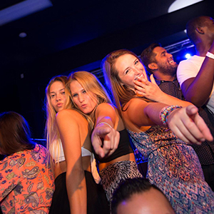 Women in a club pointing